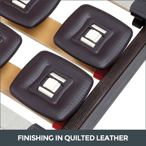 Bed base finishing in quilted leather