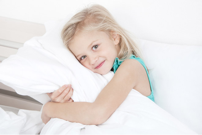 At what age should children use a pillow?
