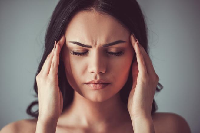 Why does a long sleep cause headaches?