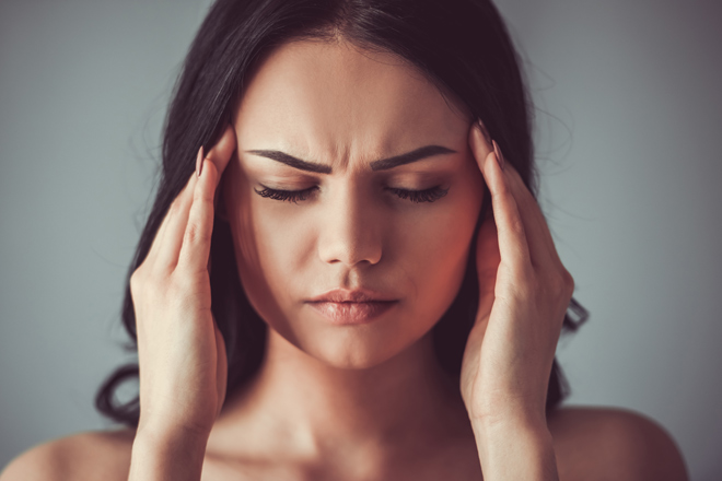 Why does a long sleep cause headaches?